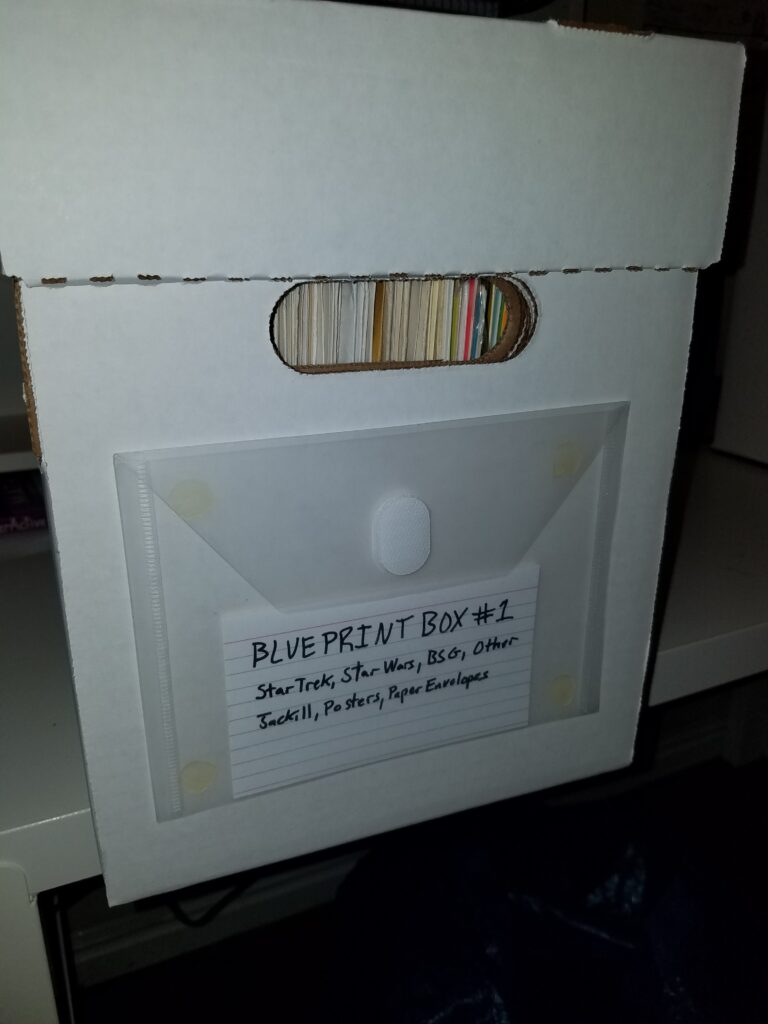 Storage envelope in use on a magazine short box.